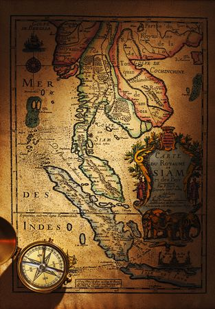 Beautiful old brass compass over antique Thailand map photo