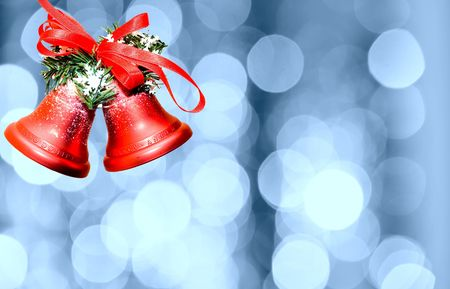 Christmas bells against defocused background with shallow depth of field and copyspace photo