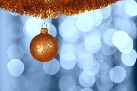 Christmas ball against defocused background with shallow depth of field and copyspace photo