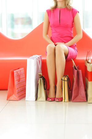 Woman with bags in shopping mall Stock Photo - 5848244
