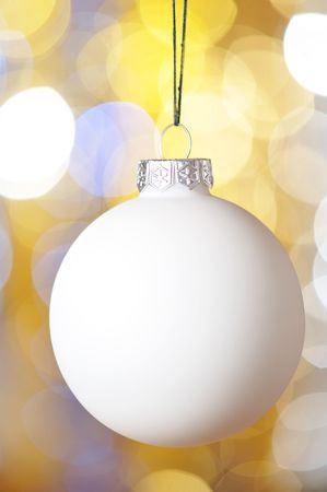 Christmas ball against defocused background with shallow depth of field photo