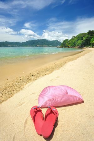 Beautiful beach landscape with hat and flip-flops in Thailand photo