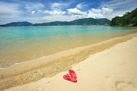 Beautiful beach landscape with flip-flops in Thailand photo