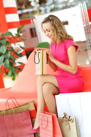 Woman with bags in shopping mall Stock Photo - 6000885