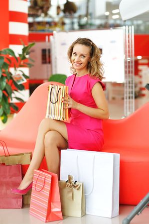 Woman with bags in shopping mall Stock Photo - 6040737