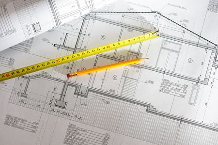 engineering plans: Pencil and tape meausure over house plan blueprints