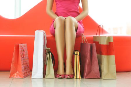 Woman with bags in shopping mall photo