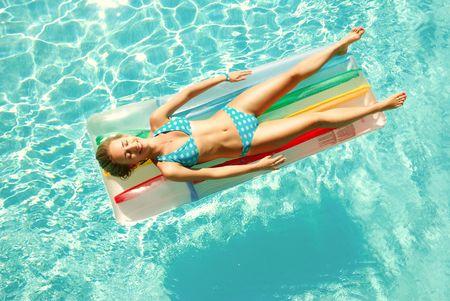 Girl in resort swimming pool photo