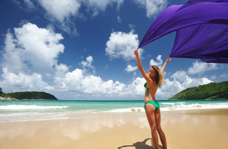 Woman with sarong on beautiful beach photo