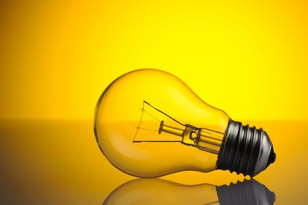 Light Bulb over yellow background Stock Photo - 6823275