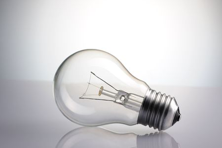 Light Bulb over grey background Stock Photo - 6906486