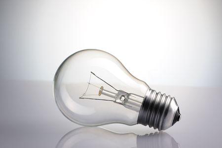 Light Bulb over grey background Stock Photo - 6906486