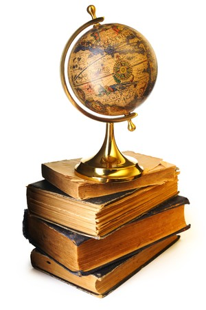Antique globe on old books isolated over white photo