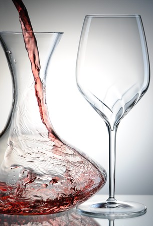 decanter: Pouring red wine into decanter Stock Photo