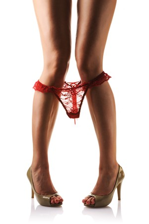 Panties are down around legs with and high heels. Isolated on  white background. Stock Photo - 7042111