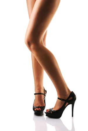 Legs with black high heels. Isolated on  white background. Stock Photo - 7060452
