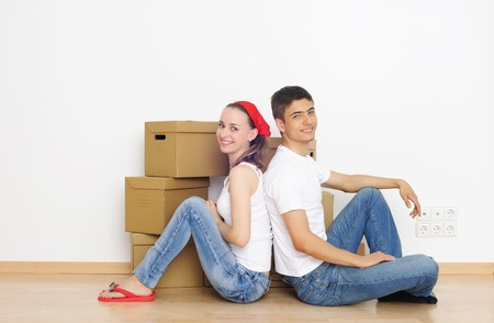 Young couple resting from moving into a new home photo
