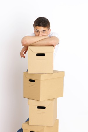 Young man with a stack of boxes photo