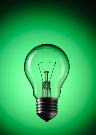 Light Bulb over green background Stock Photo - 7102294