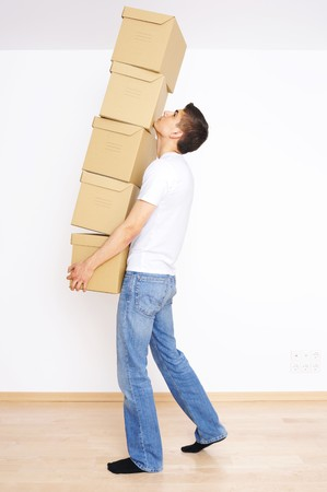 Young man carrying a stack of boxes photo