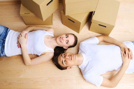 Young couple resting from moving into a new home Stock Photo - 7307945