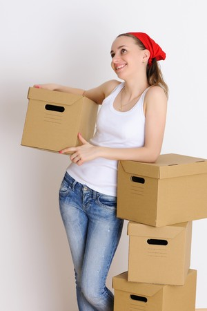 Young woman with a stack of boxes photo