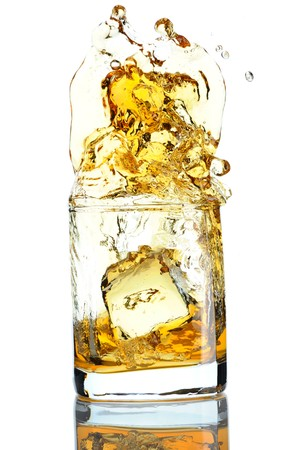 Ice cube splashing in scotch isolated on white photo