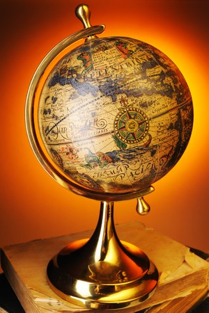 Antique globe on old books photo