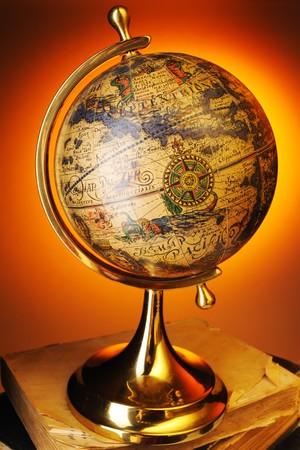 Antique globe on old books