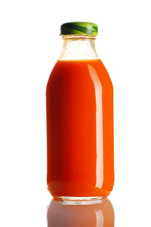 juice bottle: Carrot juice bottle isolated on white