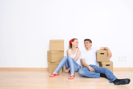 Young couple resting from moving into a new home. Great copy space. photo
