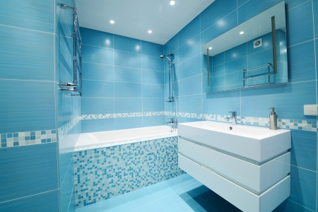 bathtubs: Modern luxury bathroom blue interior. No brandnames or copyright objects.