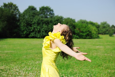 Girl with outstretched arms outdoors Stock Photo - 7354762