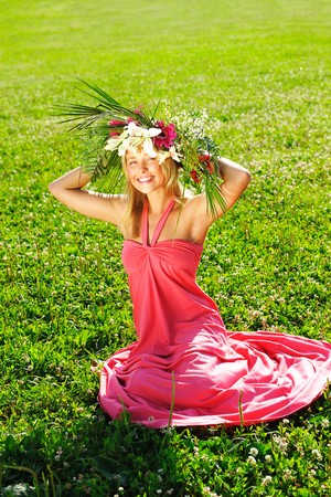 Girl with a wreath made from flowers photo