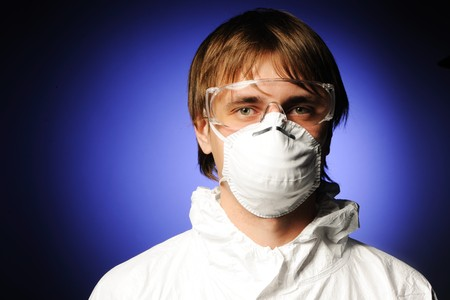 Scientist in protective wear, glasses and respirator  Stock Photo - 7837876