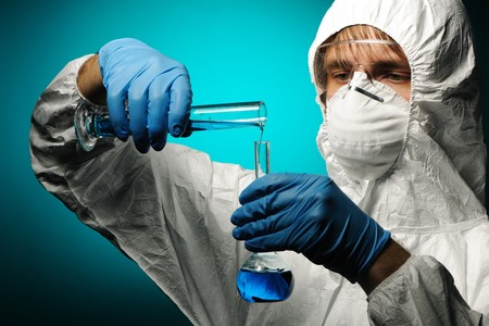 Scientist in protective wear, glasses and respirator  Stock Photo - 7837879