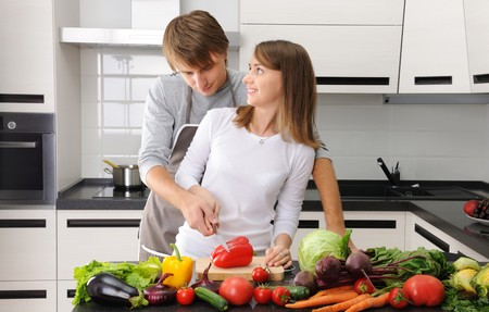 Couple cooking in modern kitchen photo