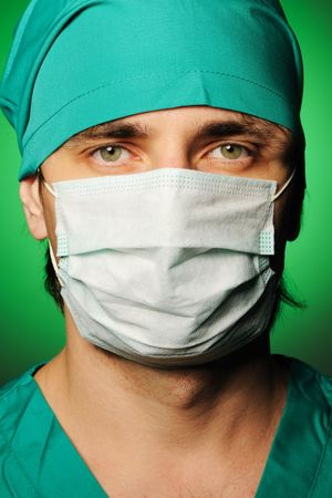Surgeon in mask over green Stock Photo - 7985892