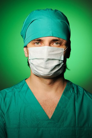 Surgeon in mask over green photo