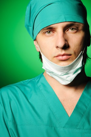 Surgeon with mask over green Stock Photo - 8037605