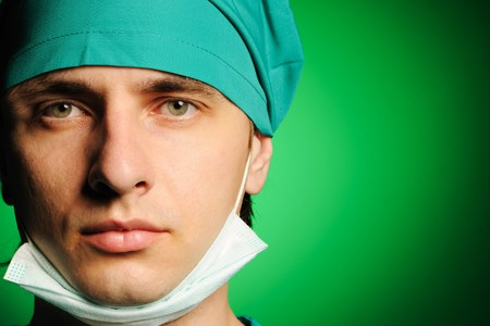 Surgeon with mask over green Stock Photo - 8037592