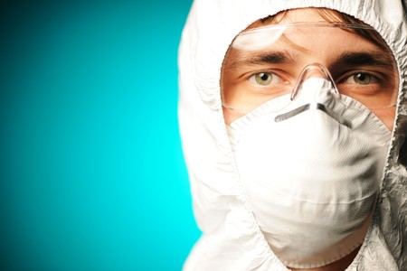 Scientist in protective wear, glasses and respirator Stock Photo - 8097858