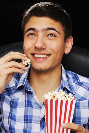 watching movie: Young man watching movie at cinema Stock Photo