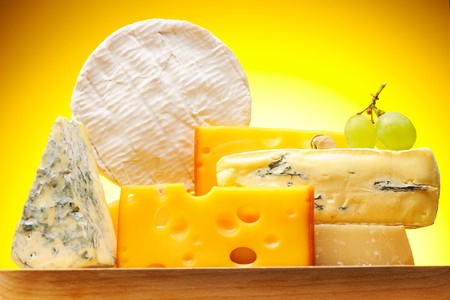 camembert: Various types of cheese on board Stock Photo