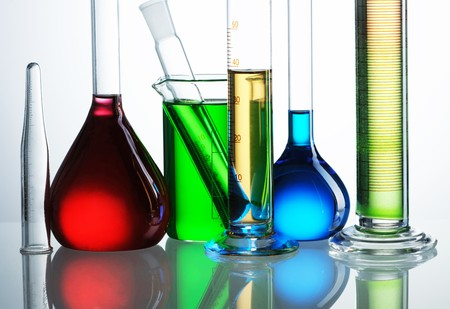Chemical flasks with reagents isolated on white background Imagens