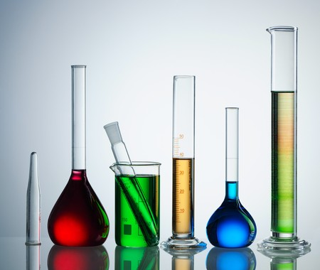 reagents: Chemical flasks with reagents over white background