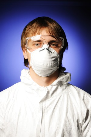 Scientist in protective wear, glasses and respirator Stock Photo - 8161692