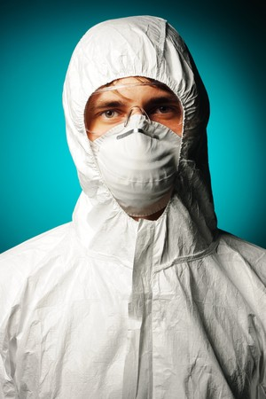 Scientist in protective wear, glasses and respirator  Stock Photo - 8161658