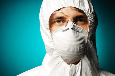 Scientist in protective wear, glasses and respirator Stock Photo - 8291977