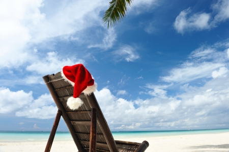 Santa's hat and chaise lounge on the beach Stock Photo - 8392608